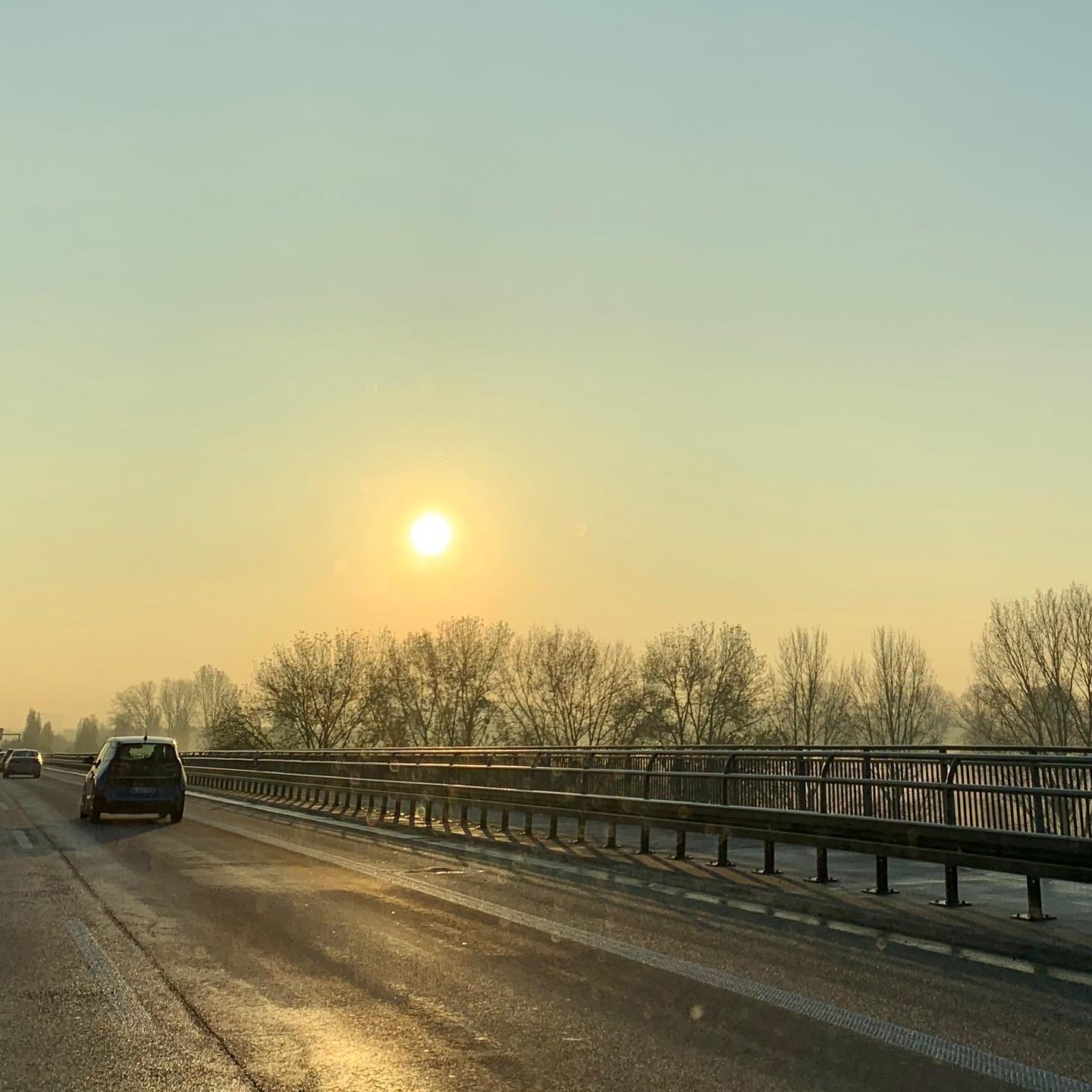 Sun, haze, German Autobahn